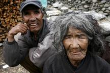 Poor old lady and her blind son, Annapurna, Nepal.jpg